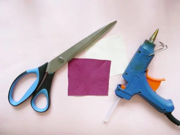 Tools and materials: scissors, hot glue gun, two fabric squares (the can be the same size).