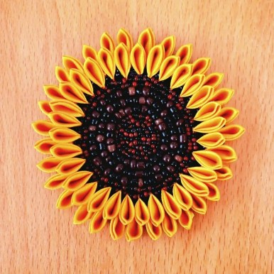 Large sunflower with brown and black seed beads embroidery