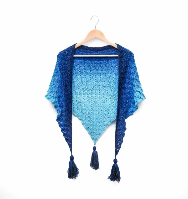 Blue gradient shawl draped over a clothes hanger