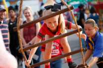 A child tries to climb a sinning ladder at the Georgia National Fair on Saturday, October 7, 2017, in Perry, Georgia. (Photo/Dori Butler)