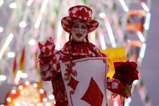 Star Childs, a performer with the Stilt Circus company from Los Angeles, California, waves as she walks through the Georgia National Fair in Perry, Georgia, on Friday, October 6, 2017. This is Childs' second year coming to perform at the fair and it has become one of her favorite fairs to participate in. Childs drove all the way from Los Angeles to Perry, Georgia to take part in the festivities for the opening weekend. (Photo/Reann Huber)
