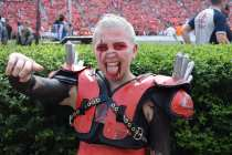 """Katie Bates, 19, a biochemistry and molecular biology major at the University of Georgia, participates as a member of the Spike Squad during the Georgia vs. Tennessee football game at Sanford Stadium, on September 29, 2018. Sitting field-level at Sanford Stadium, Bates cheers in front of the Hedges in her paint and shoulder pads. Bates says joining Spike Squad was important to her because """"I live for opportunities to be a hype man."""""""
