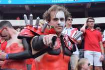 """Brooks Patterson, 20, a biological science major at the University of Georgia, participates as a member of the Spike Squad during the Georgia vs. Tennessee football game at Sanford Stadium, on September 29, 2018. Sitting field-level at Sanford Stadium, Patterson wears a Phantom of the Opera mask painted onto his face and cheers for the dogs. Patterson joined the Spike Squad because he says that he loves the Bulldogs and ,""""I love being with a group of people who love the dawgs as much as I do."""""""