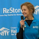 Maureen Meinhardt, director of the Greater Green Bay Habitat for Humanity ReStore, welcomes the crowd.