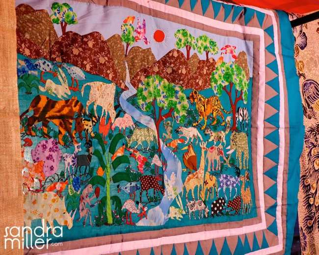 A HAND STITCHED HMONG TRIBE ANIMAL QUILT