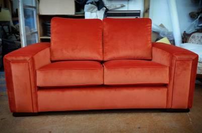 Orange Mystere velvet sofa