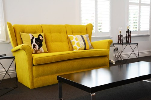 Sunshine yellow couch, recovered for the Altitude Apartments in Martinborough