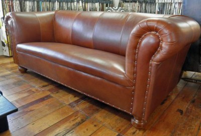 Chesterfield covered in top quality leather, finished with traditional detailing