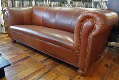 Traditional chesterfield in brown leather