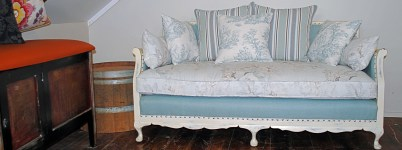 restored cane settee