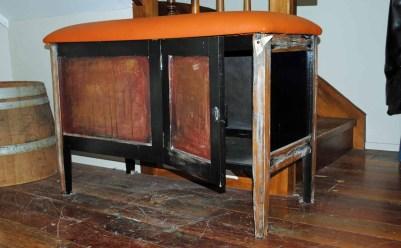 Rustic storage box with orange vinyl seat $580