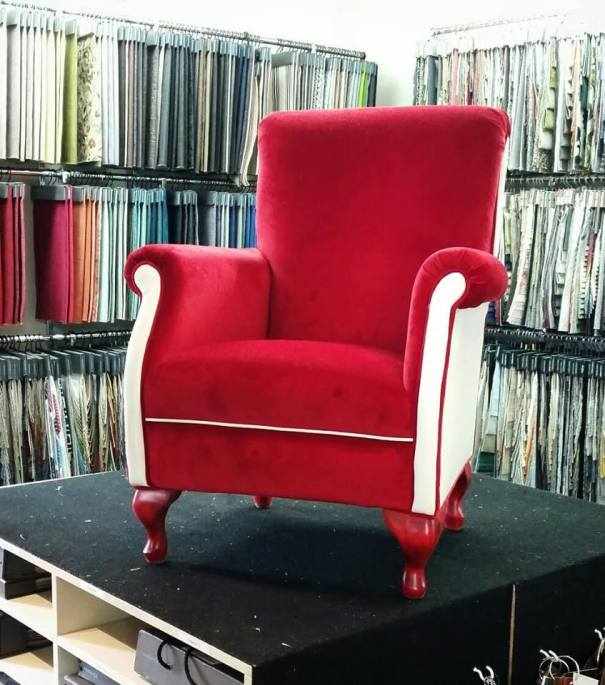 Red velvet and white vinyl chair for sale from Graham and Sons