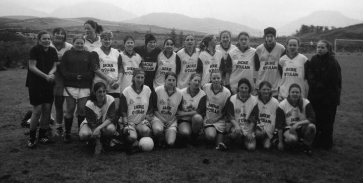 Graínne Mhaols Juniors pictured prior to their first-ever official fixture against Na Piarsaigh, which was the quarter final of the 2002 West Galway Senior Championship Tournament Back row, left to right: Emma Ridge, Bernadette Conneely, Brigid Clotherty, Lorna Flaherty, Lucy Lydon, Ann O'Neil, Priscilla Haffernan, Brid McDonagh, Geraldine McTavish (Captain), Lorraine Heffernan, Martina Conneely, Siobhán Conneely, Lisa McDonagh, Helena Lydon, Amanda Fallon. Front row, left to right: Tara Staunton, Tracey Kearney, Georgina Flaherty, Linda O'Malley, Ciara Conneely, Tara Flaherty, Mairéad Coyne, Emer Flaherty.