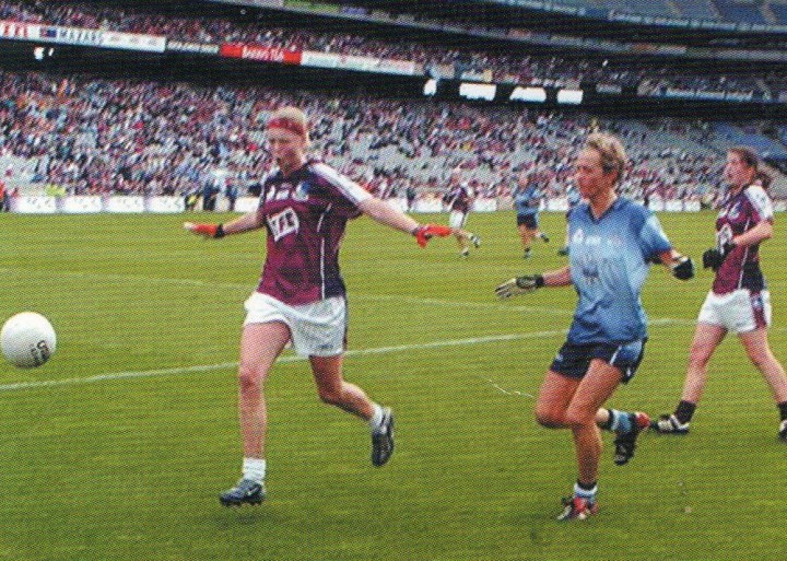 Lisa Coohill shields the ball safely out over her own endline as another Dublin attack fizzles out in the latter stages of the 2004 All-Ireland Senior Football Final in Croke Park.