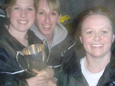 Grainne Mhaols players Danielle Lydon, Tracey Kearney and Debbie Ruddy cannot contain their delight as they smile for the camera with the Connacht Junior Championship Cup,