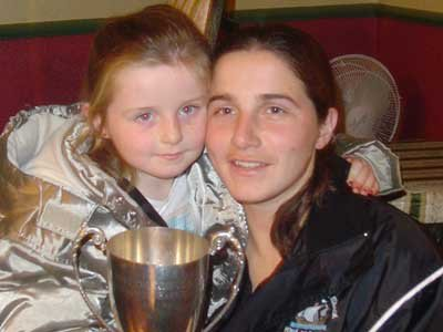 Gráinne Mhaols Captain Geraldine McTavish and her daughter Ríona pose happily with the Connacht Junior Championship Cup after Mná an Iarthair's historic victory over Geevagh in 2004. Photo courtesy of Geraldine McTavish