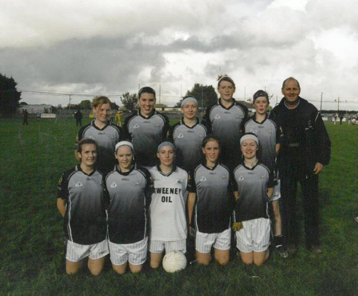 John Francis Flaherty pictured with the Grainne Mhaols Intermediates pictured prior to their 2006 West Galway Senior League victory over Spiddal in Tullycross; Back Row (l to r) Fiona Folan, Claire Kane, Helena Lydon, Maire Cloherty, Debbie Ruddy, Melissa Wallace, Lucy Lydon and Paula Coohill. Front Row (l to r) Brid McDonagh, Martina Conneely, Geraldine Conneely, Lorraine Heffernan, Maire Coyne, Mairead Coyne and Siobhan Conneely.