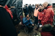 During the evictions of the camp's southern end shelters are surrounded as residents are asked to leave by French authorities, initially gently but becoming more and more forceful.
