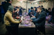 Residents play cards inside one of the afghan cafes in the Jungle. People say the most difficult thing about living in the Jungle is passing the time. Everyone dreams of having a job. 27 Feb