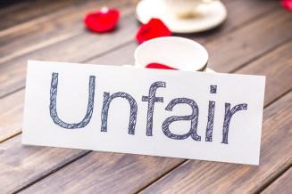 unfair to fair on white paper
