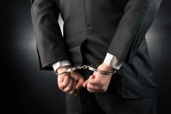 Handcuffed in suit.jpg