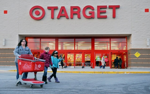 Shoppers leave a retail Target on Thursday, Dec. 19, 2013, in Hackensack, N.J. Target says that about 40 million credit and debit card accounts customers may have been affected by a data breach that occurred at its U.S. stores between Nov. 27 and Dec. 15. (AP Photo/Northjersey.com, Amy Newman) ONLINE OUT; MAGS OUT; TV OUT; INTERNET OUT; NO ARCHIVING; MANDATORY CREDIT