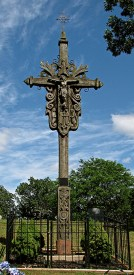 This remarkable cross of wrought iron and hand-carved cedar was erected at the Lithuanian SS. Peter & Paul Cemetery in 1989.