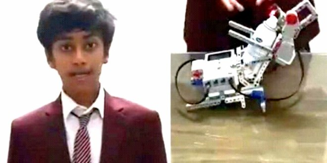 STUDENT DESIGNS COVID-19  HAND SANITIZER ROBOT!