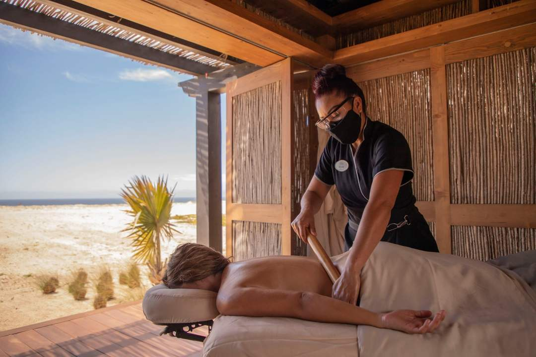 spa treatment with the ocean breeze caressing you