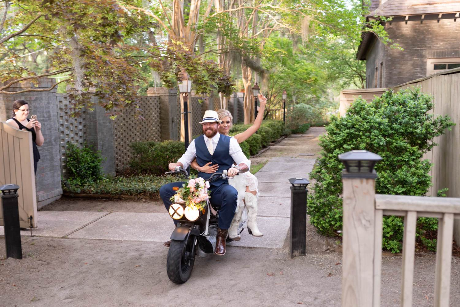 Bride and groom riding in on a scooter - Brookgreen Gardens