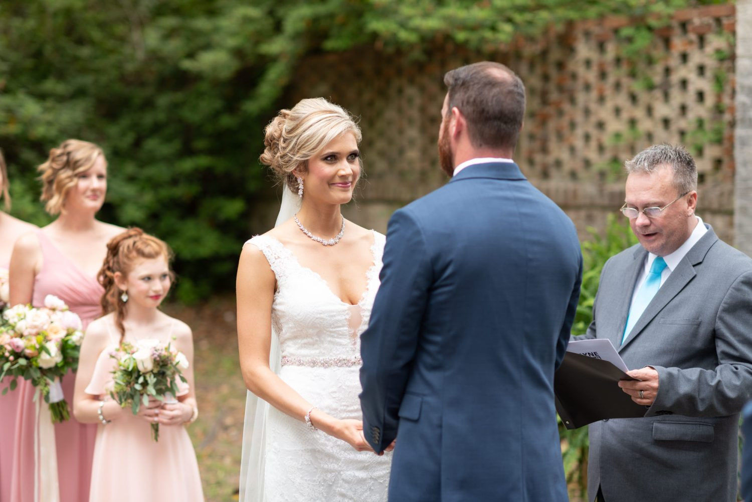 Bride smiling at groom during the ceremony - Brookgreen Gardens