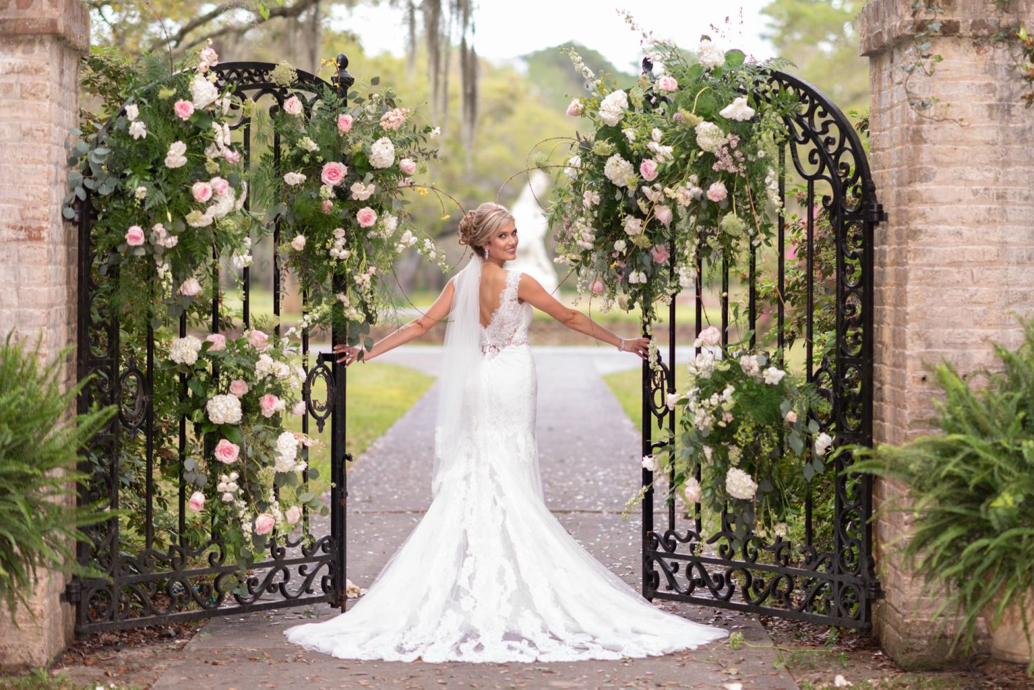 Bride walking through the garden gates - Brookgreen Gardens