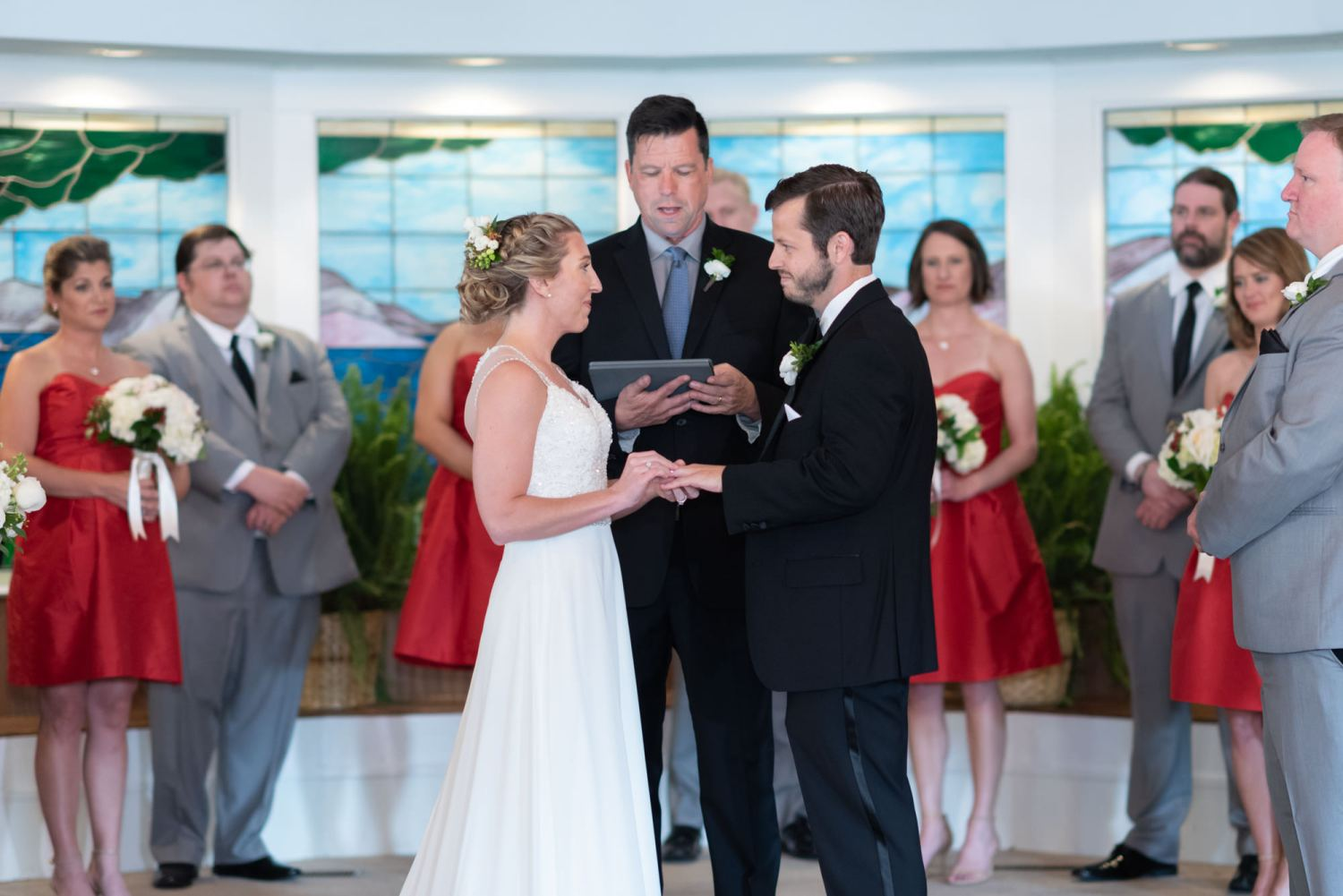 Bride and groom exchanging rings - Pawleys Island Community Chapel