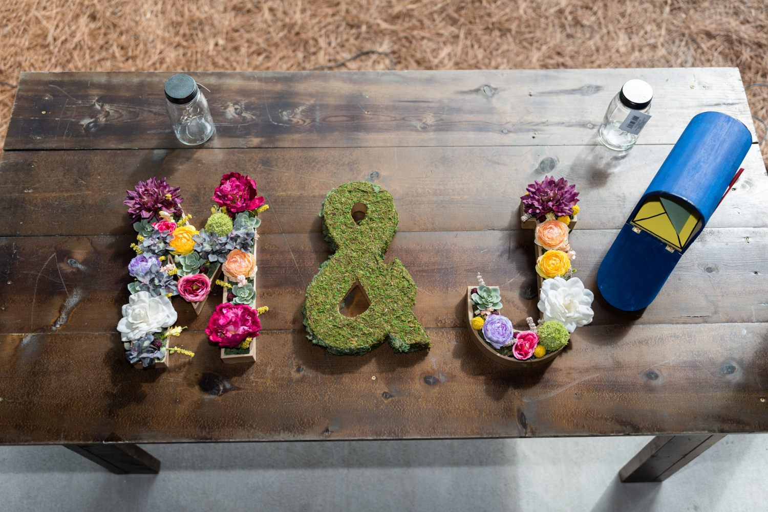 Flower bed monograms of bride and groom - Wildhorse at Parker Farms
