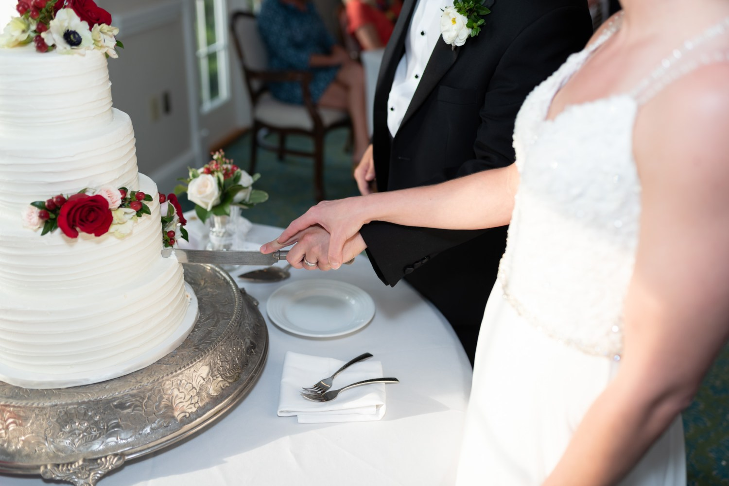 Holding hands cutting the cake - Wachesaw Plantation