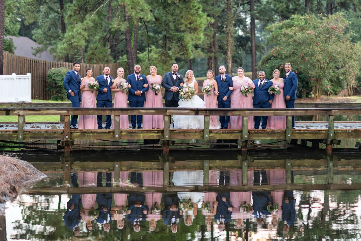 Bridal party on the bridge reflecting in the water - Litchfield Country Club