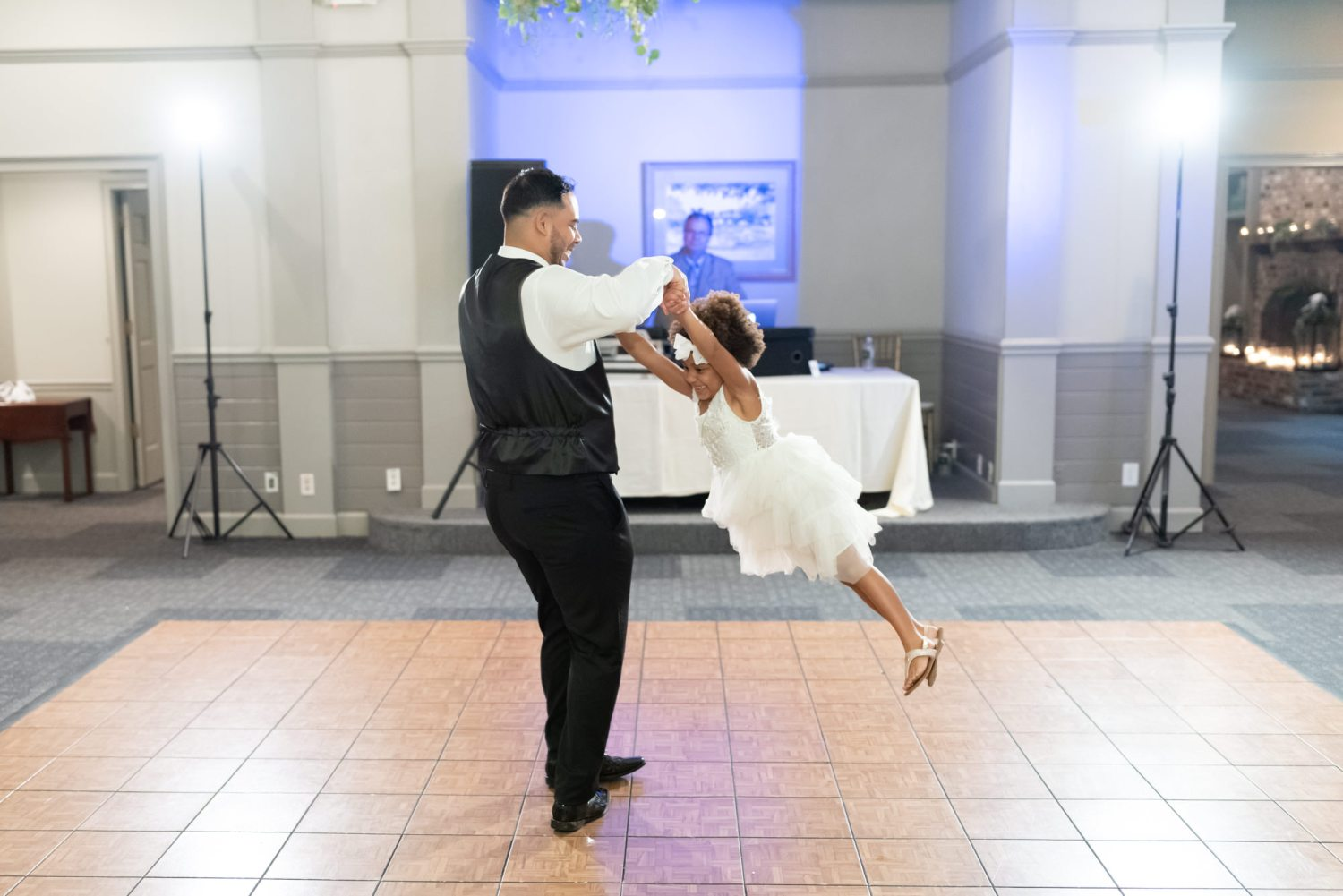 Groom spinning flower girl on the dance floor - Litchfield Country Club