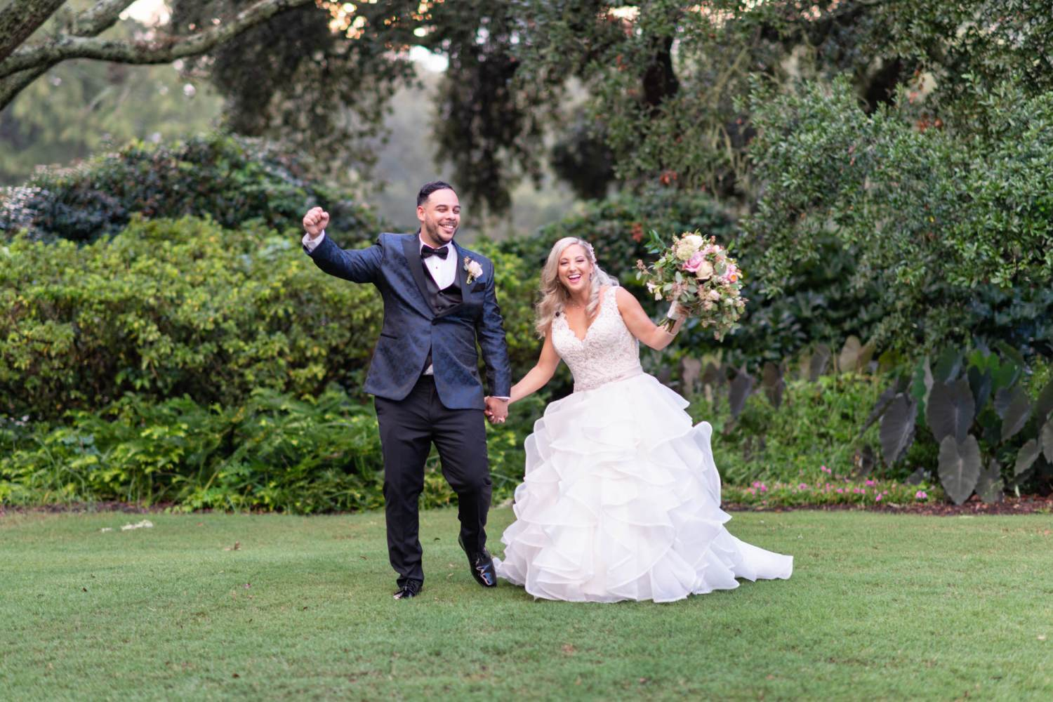 Happy bride and groom cheering on the lawn - Litchfield Country Club