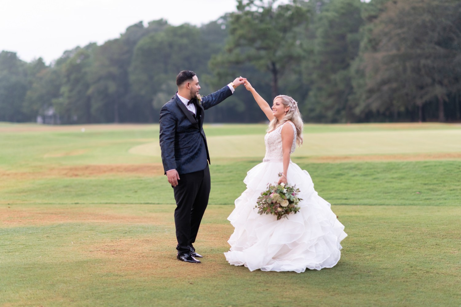 Spinning bride around on the golf course - Litchfield Country Club