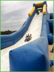 Adults and Kids Coming Down the Slide