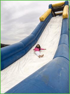 Girl Halfway Down the Water Slide