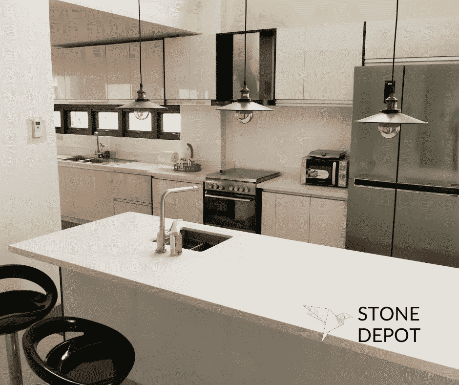 White engineered quartz countertop and kitchen island in Carmen, Cebu