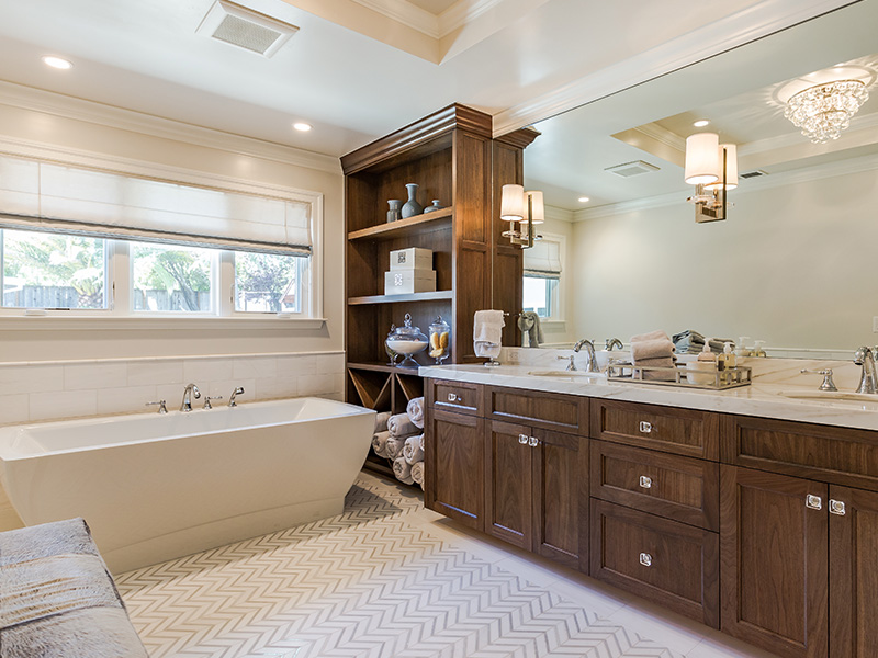 white bathroom with wooden cabinet