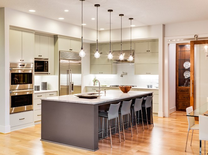 kitchen island with hanging lamps