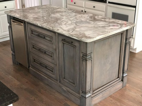 grey kitchen island with swirl marble