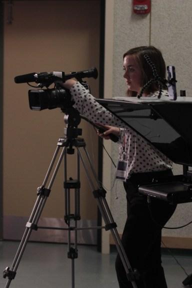 SHS junior Anna Waldron films the interview.