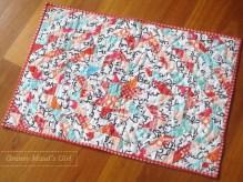 Scrappy humidicrib mini quilt made with half-square triangles
