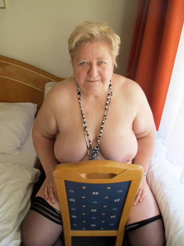 Busty Granny Strips Down Naked And Plays With A Bottle