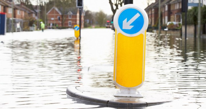 Flooded Urban Road With Traffic Lights