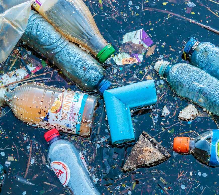 Plastic waste floating in a canal in Amsterdam, The Netherlands